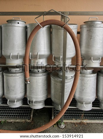 Several milk churns in a row at the dairy - stock photo