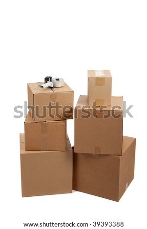 Several moving boxes and a tape gun on a white background - stock photo