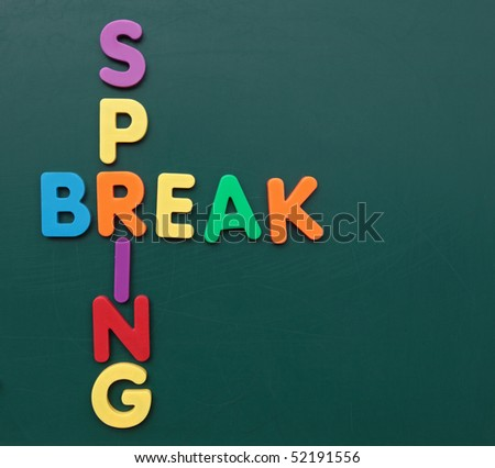 Several multicolored bold letters build the term spring break on a blackboard. - stock photo