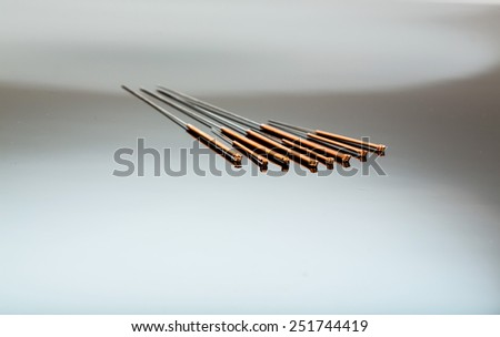 several needle for acupuncture are adjacent.  - stock photo