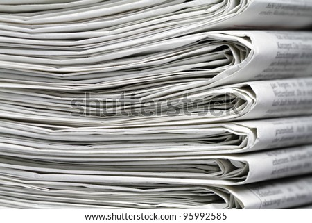 Several newspapers on one another and form a stack. - stock photo