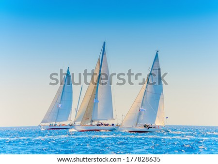 several Old classic wooden racing sailing boats  during a Classic Boats Regatta in Spetses island in Greece - stock photo