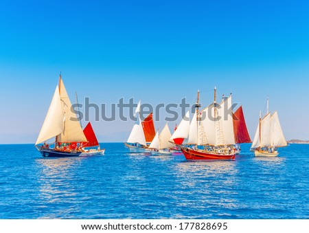 several Old classic wooden sailing boats  during a Classic Boats Regatta in Spetses island in Greece - stock photo