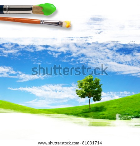 several paintbrushes and nature landscape on the background - stock photo