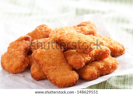 Several pieces of fresh and delicious chicken nuggets - stock photo