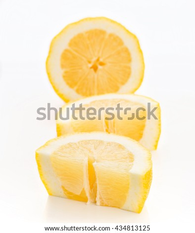 several pieces of lemon, isolated on white, takes Vertical