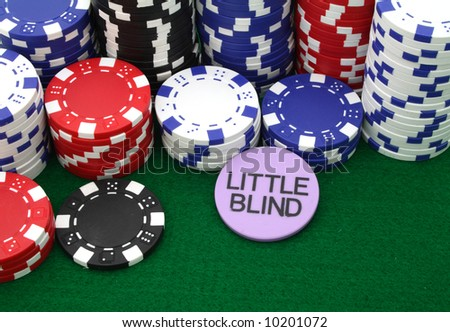 several piles of gambling chips over a green table