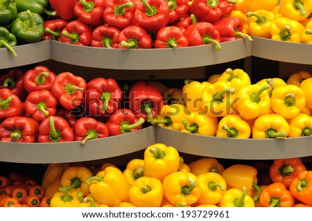 Several pods of varicolored sweet pepper, capsicum - stock photo