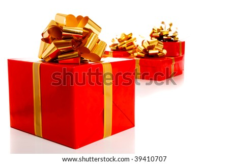Several present boxes wrapped into red paper