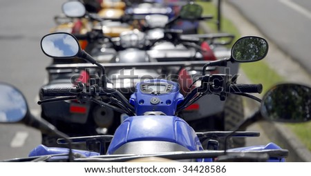 Several quads parked in the street - stock photo