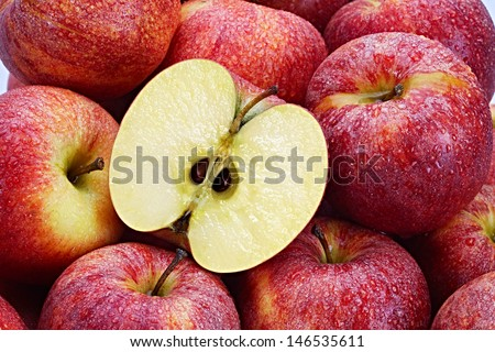 Several Red Apples with cut apple in the foreground - stock photo