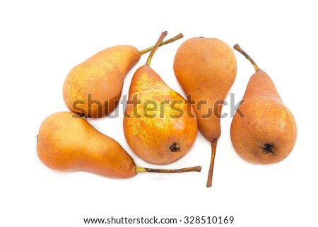 Several ripe yellow and light brown European pears of autumn variety Bere Bosc on a light background. Isolation. - stock photo