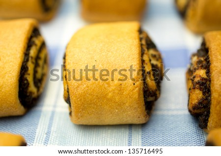 Several rolls with poppy seeds on a napkin