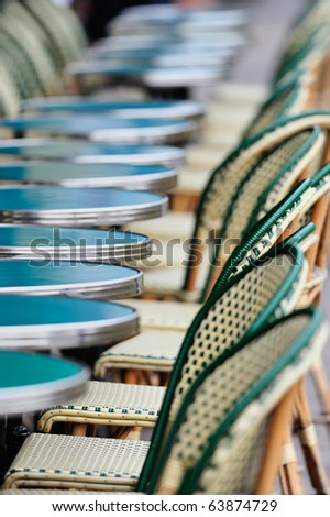 Several round tables and chairs in cafe in Paris. Photo with tilt-shift effect - stock photo