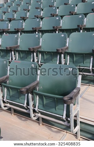 Several rows of seats in a stadium - stock photo