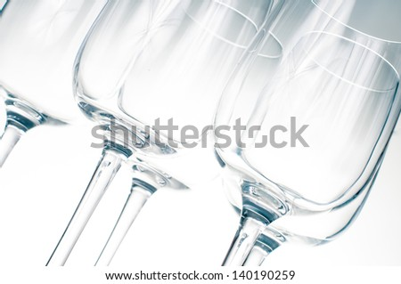 Several same empty  wine glasses in gray shades - stock photo