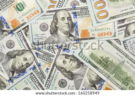 Several Scattered Layer of the Newly Designed U.S. One Hundred Dollar Bills. - stock photo