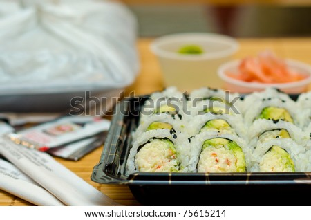 Several sets of sushi to go. - stock photo