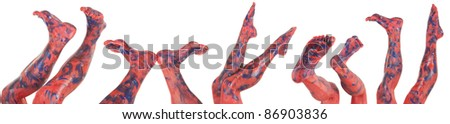 Several sets of womens feet and legs with red and blue paint on them. - stock photo