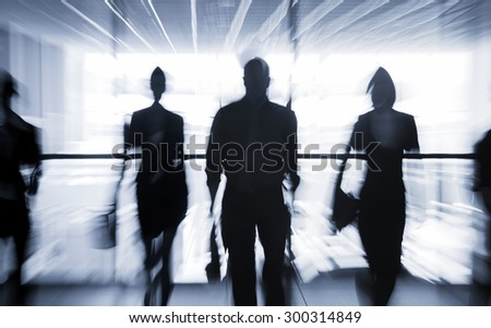 Several silhouettes of businesspeople interacting office background - stock photo