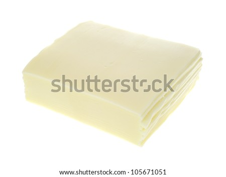 Several slices of white American cheese on a white background.