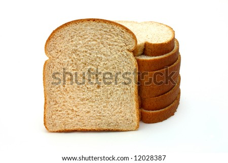 several slices of whole grain bread over a white surface - stock photo