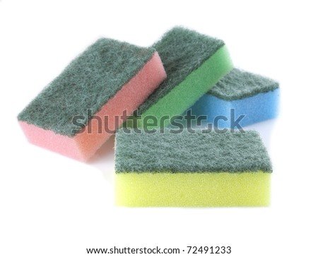 Several sponges on a white background.
