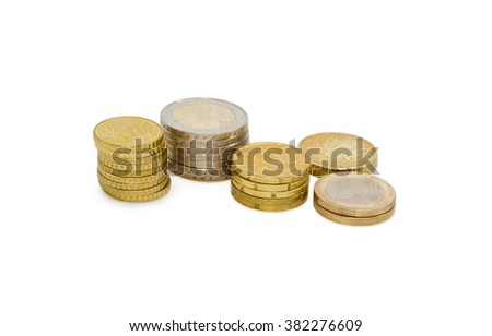 Several stacked euro coins from ten to fifty cents, and in denominations of 1 and 2 euro on a light background  - stock photo