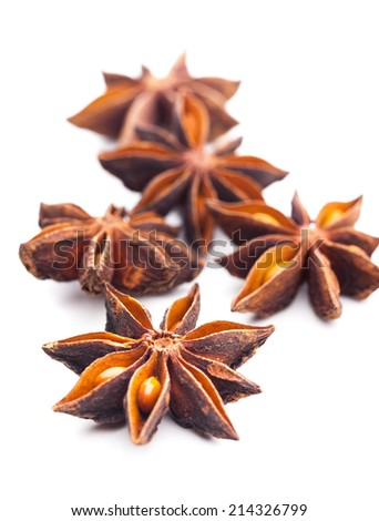Several star anise isolated on white background - stock photo