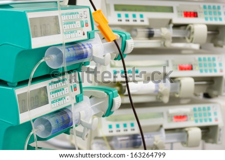 Several syringe pumps in intensive care unit - stock photo