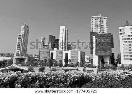 Several tall buildings black and white - stock photo