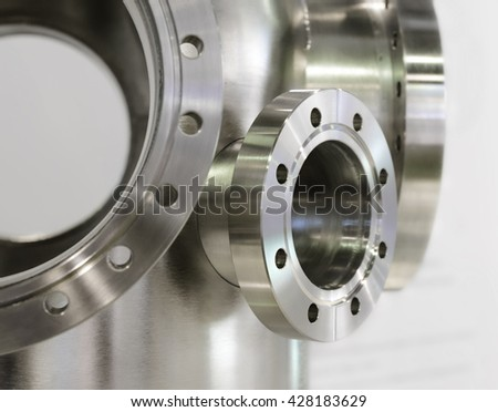 Several thick metal flange mounted on the casing. - stock photo