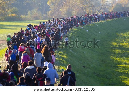 Several thousand refugees are wandering into the direction of Deutscland Dramatical picture from European refugees crisis see my collection from refugees 25.10.2015 Slovenia Breznice;  - stock photo