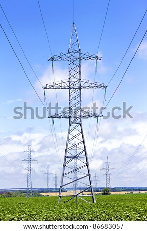 several transmission lines in the middle of a  field - stock photo