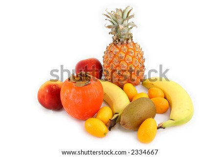 several tropical fruits arranged over a white beackground - stock photo