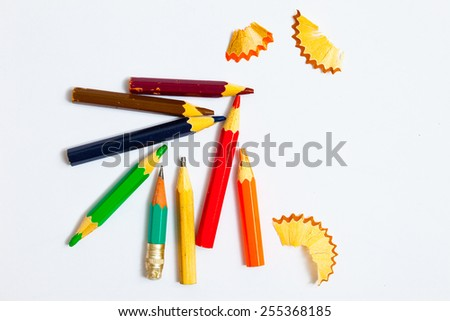 several vintage pencils and shavings on a white background, close-up - stock photo