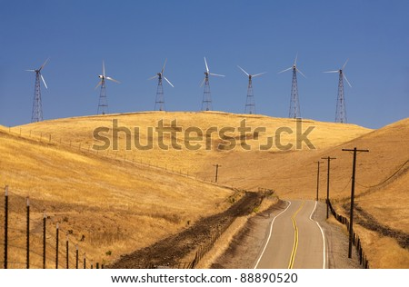 Several windmills in a row. - stock photo