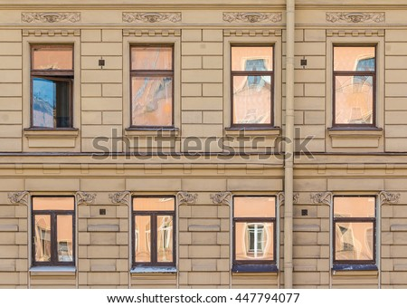 Several Windows In A Row On Facade Of Urban Apartment Building Front View,  St.