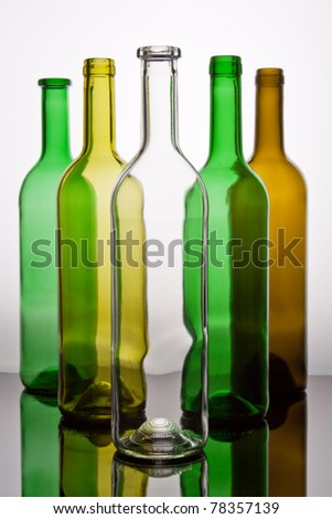 Several wine bottles in green, brown and transparent. - stock photo