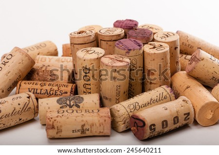 "Several Wine Corks on a white background. You can read "" Mis en Bouteille"" (filled in the bottle or bottled) or the Origin of the Wine and or the Vintage on them. - stock photo"