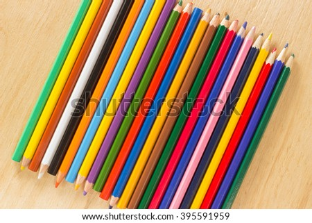 Several wooden colored pencils stacked in a row for background - stock photo