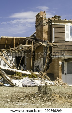 Severe storm damage: Part of a single-family two-story house hit by a tornado in central Illinois, USA