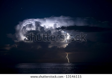 Severe thunderstorm and lightning out to sea - stock photo