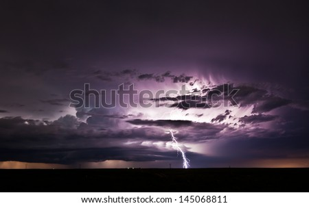 Severe thunderstorm with lots of lightnings - stock photo