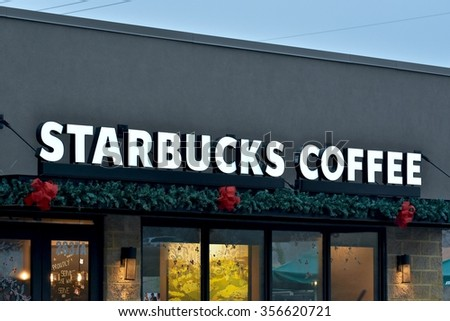 SEVERN, MD, USA - DECEMBER 30, 2015: Starbucks storefront in Severn, Maryland. Starbucks Corporation is an American coffee company and coffeehouse chain.