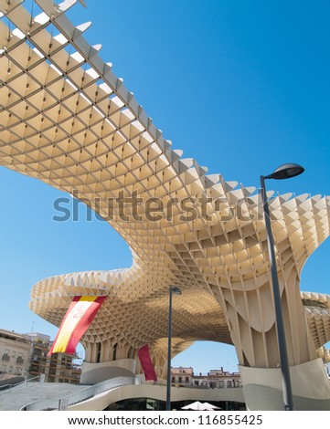 SEVILLA,SPAIN - JUNE 2012: Metropol Parasol in Plaza de la Encarnacion on June 2012 in Sevilla,Spain. J. Mayer H. architects, it is made from bonded timber with a polyurethane coating. - stock photo