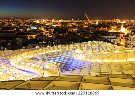 SEVILLA,SPAIN JUNE 04 : Metropol Parasol in Plaza de la Encarnacion on June 04, 2014 in Sevilla, Spain. J. Mayer H. architects, it is made from bonded timber with a polyurethane coating. - stock photo