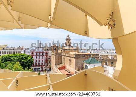 SEVILLA,SPAIN -JUNE 06 : Metropol Parasol in Plaza de la Encarnacion on June 06, 2014 in Sevilla, Spain. J. Mayer H. architects, it is made from bonded timber with a polyurethane coating. - stock photo