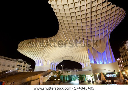 SEVILLA,SPAIN -SEPTEMBER 17, 2013 : Metropol Parasol in Plaza de la Encarnacion . J. Mayer H. architects, it is made from bonded timber with a polyurethane coating.  - stock photo