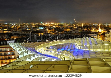 SEVILLA,SPAIN -SEPTEMBER 27: Metropol Parasol in Plaza de la Encarnacion on September 27, 2012 in Sevilla,Spain. J. Mayer H. architects, it is made from bonded timber with a polyurethane coating. - stock photo